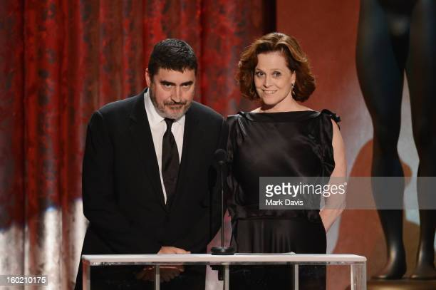 Actors Alfred Molina and Sigourney Weaver speak onstage during the 19th Annual Screen Actors Guild Awards held at The Shrine Auditorium on January 27...