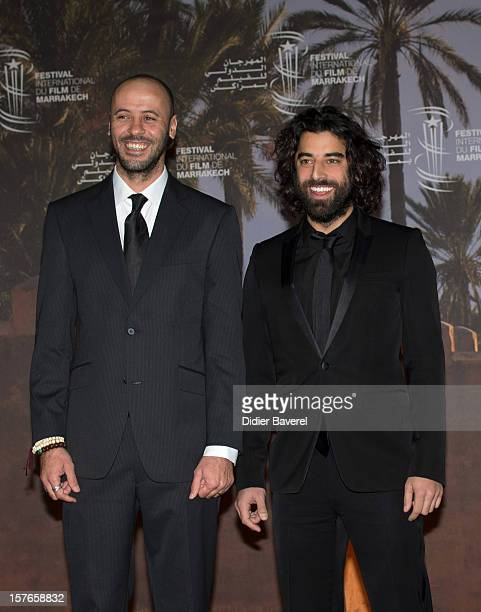 Actors Ali Suliman and Karim Saleh pose during a photocall for the movie ' The Attack' at 12th International Marrakech Film Festival on December 5...