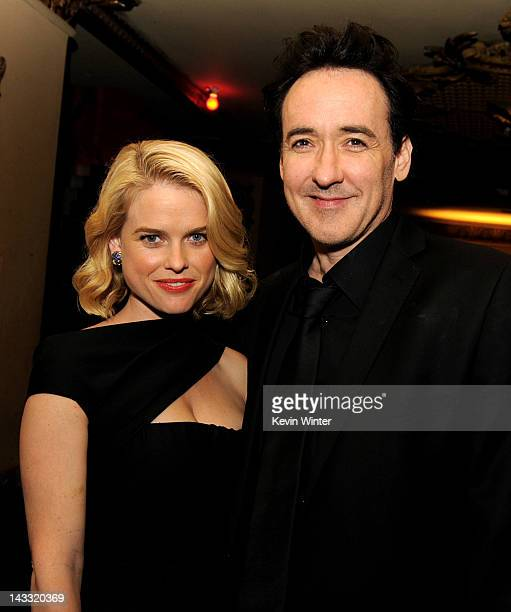 Actors Alice Eve and John Cusack pose at the after party for a special screening of Relativity Media's The Raven at the Los Angeles Theater on April...