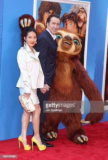 Actors Alice Kim and Nicolas Cage attend The Croods premiere at AMC Loews Lincoln Square 13 theater on March 10 2013 in New York City
