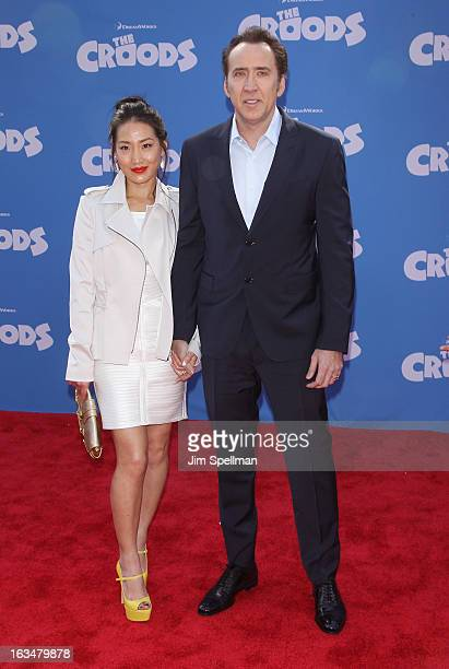 Actors Alice Kim and Nicolas Cage attend 'The Croods' premiere at AMC Loews Lincoln Square 13 theater on March 10 2013 in New York City