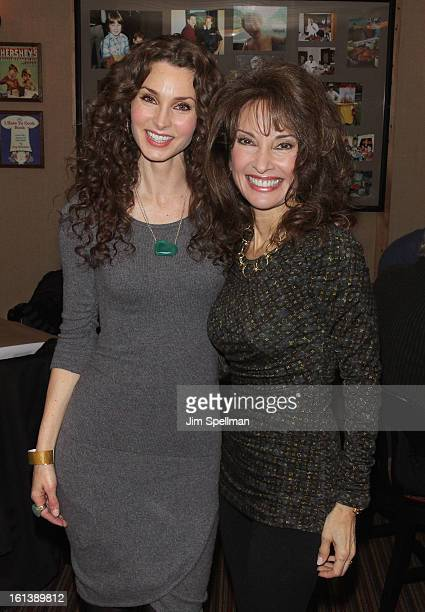 Actors Alicia Minshew and Susan Lucci attend the Spontaneous Construction premiere at Guys American Kitchen Bar on February 10 2013 in New York City