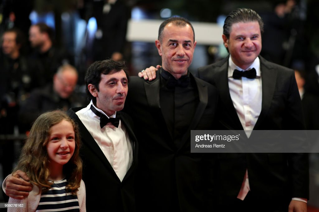 Actors Alida Baldari Calabria, Marcello Fonte, director Matteo Garrone and actor Edoardo Pesce attend the screening of 'Dogman' during the 71st annual Cannes Film Festival at Palais des Festivals on May 16, 2018 in Cannes, France.