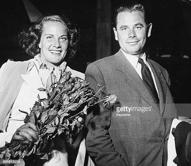 Actors Alida Valli and Glenn Ford stars of the new RKO Production 'The White Tower' arriving to begin filming at the Gare SaintLazare in Paris August...