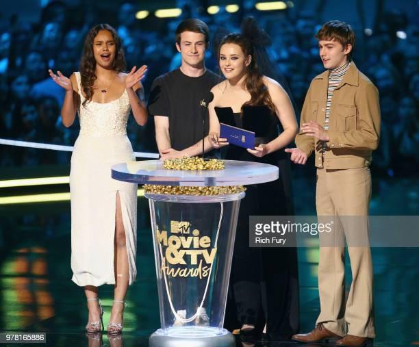 Actors Alisha Boe Dylan Minnette Katherine Langford and Miles Heizer speak onstage during the 2018 MTV Movie And TV Awards at Barker Hangar on June...