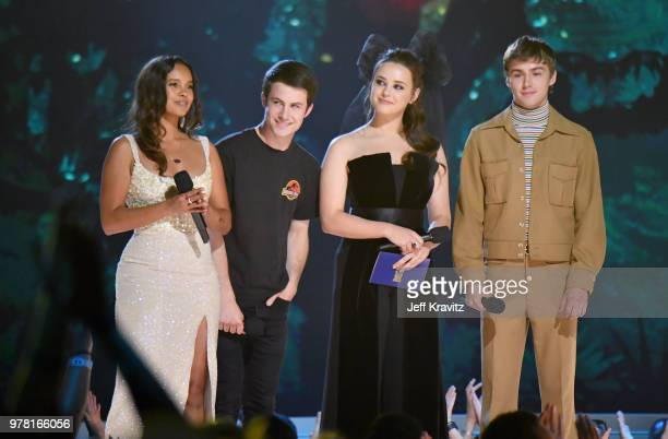 Actors Alisha Boe Dylan Minnette Katherine Langford and Miles Heizer speak onstage at the 2018 MTV Movie And TV Awards at Barker Hangar on June 16...