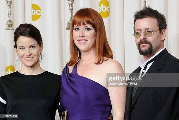 Actors Ally Sheedy Molly Ringwald and Judd Nelson who presented a tribute to late director John Hughes pose in the press room at the 82nd Annual...