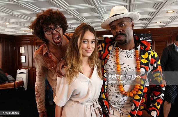 Actors Alycia DebnamCarey and Coleman Domingo with a cosplayer attend AMC at ComicCon on July 23 2016 in San Diego California