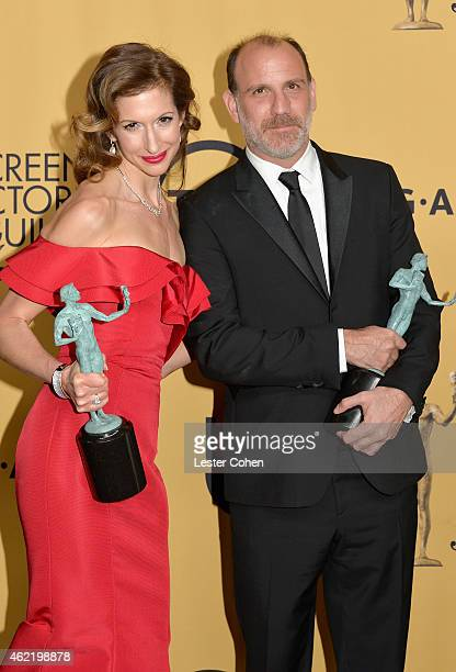 Actors Alysia Reiner and Nick Sandow pose in the press room at the 21st Annual Screen Actors Guild Awards at The Shrine Auditorium on January 25 2015...