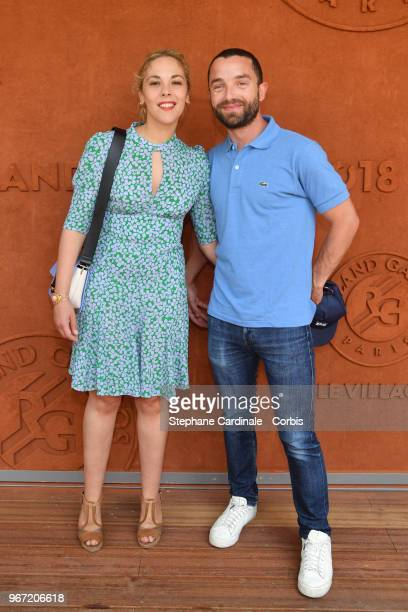 Actors Alysson Paradis and Guillaume Gouix attend the 2018 French Open Day Nine at Roland Garros on June 4 2018 in Paris France