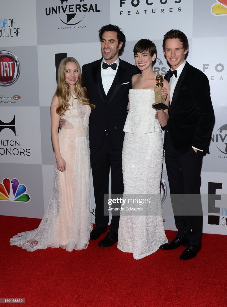 Actors Amanda Seyfried, Sacha Baron Cohen, Anne Hathaway and Eddie Redmayne arrive at the NBC Universal's 70th Golden Globes After Party at The Beverly Hilton Hotel on January 13, 2013 in Beverly Hills, California.