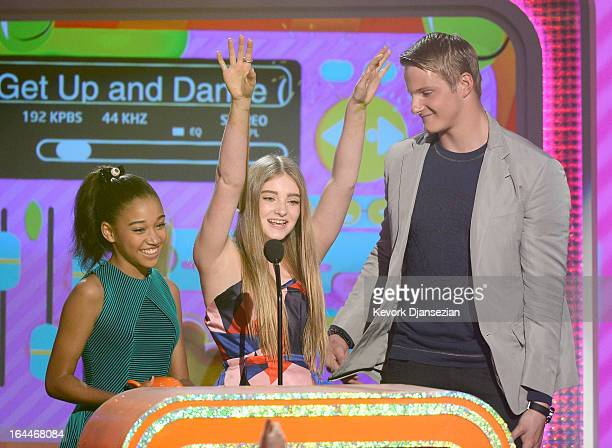 Actors Amandla Stenberg Willow Shields and Alexander Ludwig accept Favorite Movie award for The Hunger Games onstage during Nickelodeon's 26th Annual...