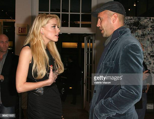 Actors Amber Heard and Billy Zane attend The Tasya Van Ree Art Exhibit hosted by Amber Heard on February 11 2010 in Beverly Hills California
