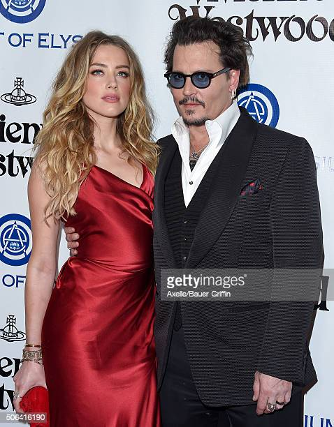 Actors Amber Heard and Johnny Depp attend Art of Elysium's 9th Annual Heaven Gala at 3LABS on January 9 2016 in Culver City California