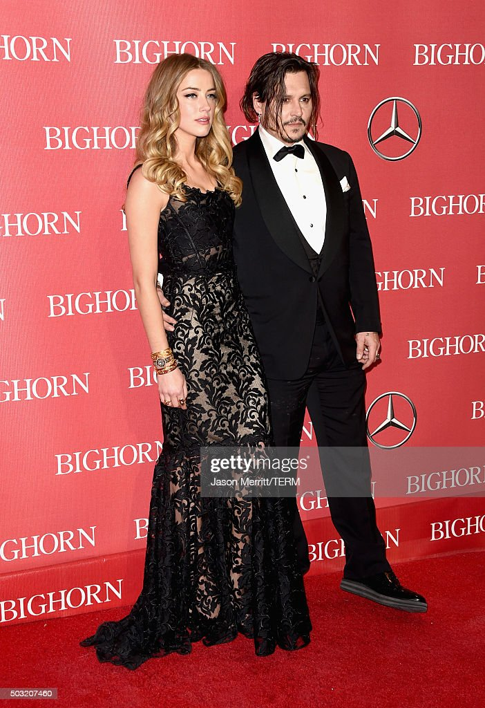 Actors Amber Heard (L) and Johnny Depp attend the 27th Annual Palm Springs International Film Festival Awards Gala at Palm Springs Convention Center on January 2, 2016 in Palm Springs, California.