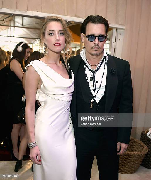 Actors Amber Heard and Johnny Depp attend the 8th Annual HEAVEN Gala presented by Art of Elysium and Samsung Galaxy at Hangar 8 on January 10, 2015...
