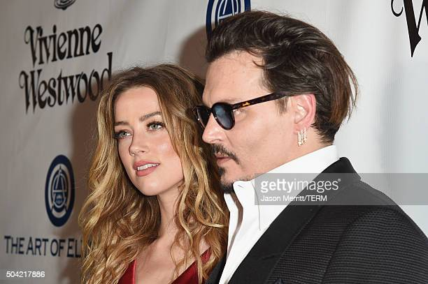 Actors Amber Heard and Johnny Depp attend The Art of Elysium 2016 HEAVEN Gala presented by Vivienne Westwood Andreas Kronthaler at 3LABS on January 9...