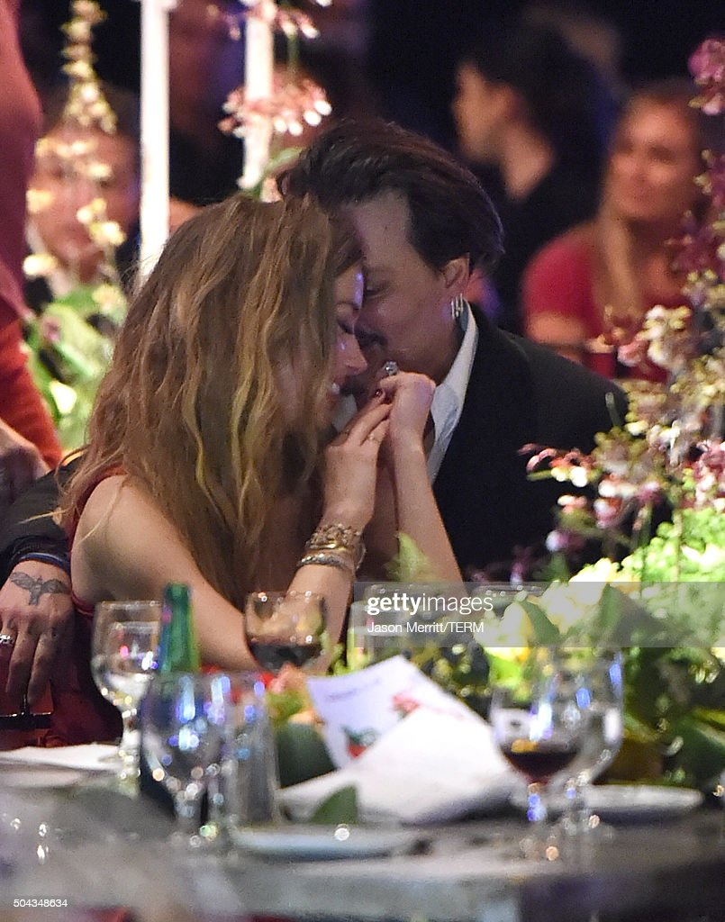 Actors Amber Heard and Johnny Depp attend The Art of Elysium 2016 HEAVEN Gala presented by Vivienne Westwood & Andreas Kronthaler at 3LABS on January 9, 2016 in Culver City, California.