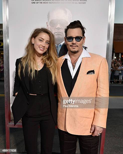 Actors Amber Heard and Johnny Depp attend the 'Black Mass' Boston special screening at the Coolidge Corner Theatre on September 15 2015 in Boston...