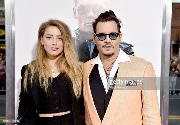 Actors Amber Heard and Johnny Depp attend the Black Mass Boston special screening at the Coolidge Corner Theatre on September 15 2015 in Boston...