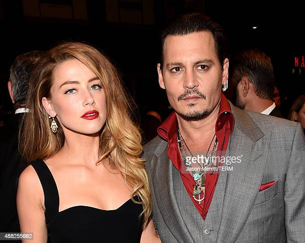 "Actors Amber Heard and Johnny Depp attend the ""Black Mass"" premiere during the 2015 Toronto International Film Festival at The Elgin on September 14,..."