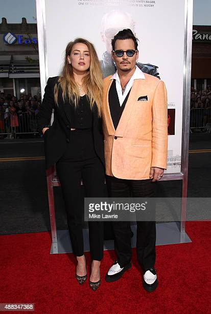 """Actors Amber Heard and Johnny Depp attend the Boston premiere of """"Black Mass"""" at Coolidge Corner Theater on September 15, 2015 in Brookline,..."""