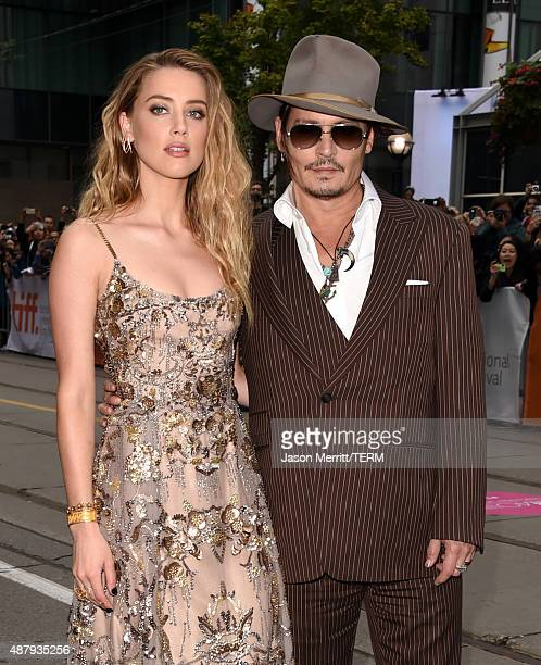 "Actors Amber Heard and Johnny Depp attend ""The Danish Girl"" premiere during the 2015 Toronto International Film Festival at the Princess of Wales..."