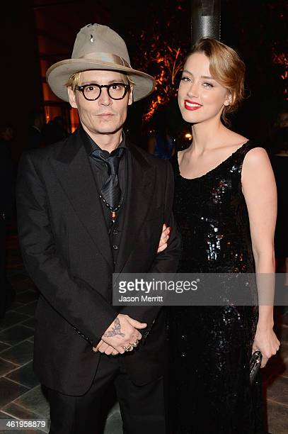 Actors Amber Heard and Johnny Depp attends The Art of Elysium's 7th Annual HEAVEN Gala presented by Mercedes-Benz at Skirball Cultural Center on...