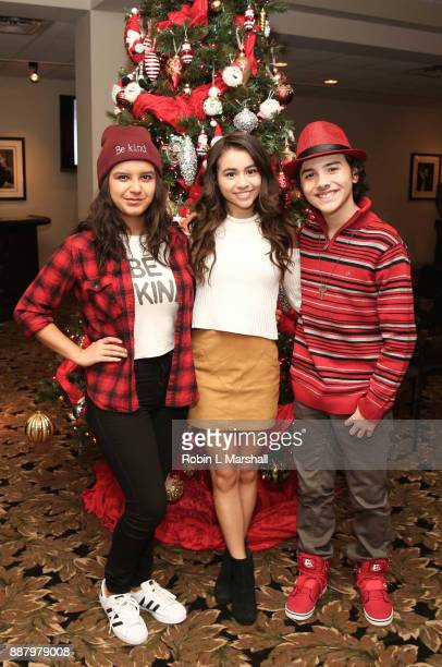 Actors Amber Romero Ciara A Wilson and Hunter Payton attend the Holiday Tour of the Hollywood Museum at The Hollywood Museum on December 7 2017 in...