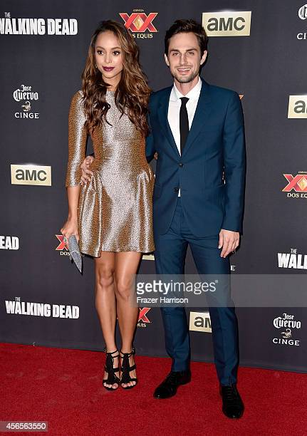 Actors Amber Stevens and Andrew J West attend the season 5 premiere of 'The Walking Dead' at AMC Universal City Walk on October 2 2014 in Universal...