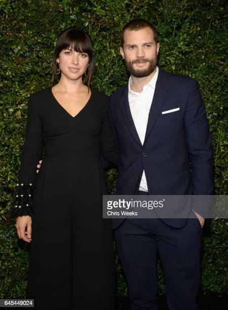 Actors Amelia Warner and Jamie Dornan attend the Charles Finch and CHANEL PreOscar Awards Dinner at Madeo Restaurant on February 25 2017 in Beverly...