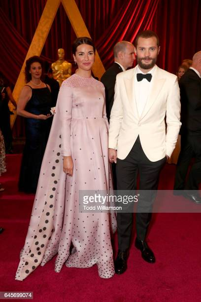 Actors Amelia Warner and Jamie Dornan attends the 89th Annual Academy Awards at Hollywood Highland Center on February 26 2017 in Hollywood California