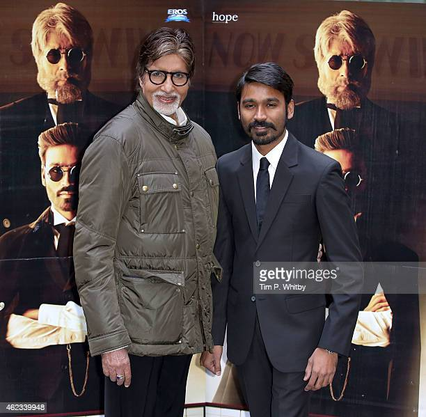 Actors Amitabh Bachchan and Dhanush attend a photocall for 'Shamitabh' at St James Court Hotel on January 27 2015 in London England