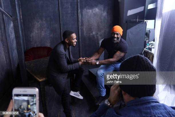 Actors Aml Ameen and Idris Elba from 'Yardie' attend The Hollywood Reporter 2018 Sundance Studio at Sky Strada Park City on January 20 2018 in Park...