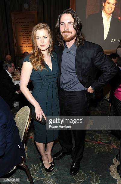 Actors Amy Adams and Christian Bale attend the Eleventh Annual AFI Awards reception at the Four Seasons Hotel on January 14 2011 in Los Angeles...