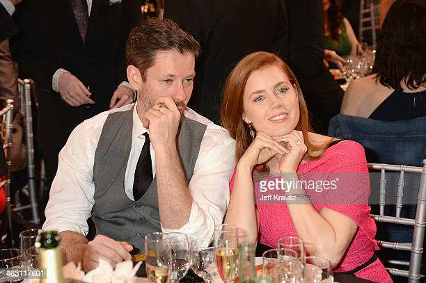 Actors Amy Adams and Darren Le Gallo attend the 19th Annual Critics' Choice Movie Awards at Barker Hangar on January 16 2014 in Santa Monica...
