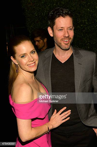 Actors Amy Adams and Darren Le Gallo attend Vanity Fair and Chrysler Toast American Hustle during Vanity Fair Campaign Hollywood at Ago on February...
