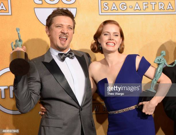 Actors Amy Adams and Jeremy Renner pose for a portrait during 20th Annual Screen Actors Guild Awards at The Shrine Auditorium on January 18 2014 in...