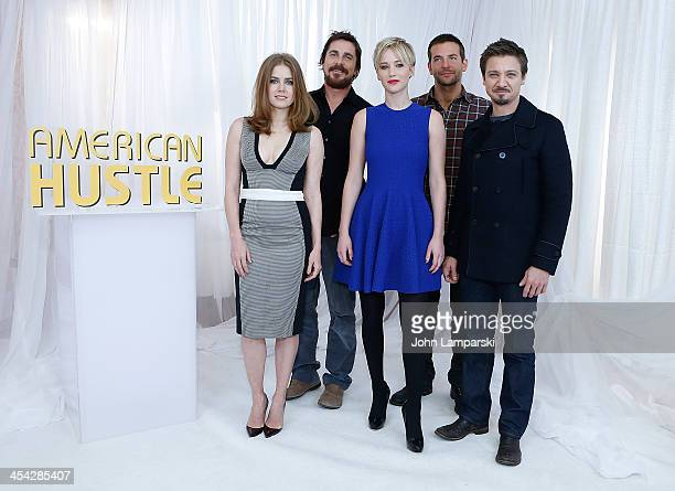 """Actors Amy Adams, Christian Bale, Jennifer Lawrence, Bradley Cooper and Jeremy Renner attend the """"American Hustle"""" cast photocall at Crosby Street..."""
