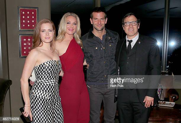 Actors Amy Adams Elisabeth Rohm Bradley Cooper and director David O Russell attend PANDORA Jewelry and Moto X present 'American Hustle' at cinema...