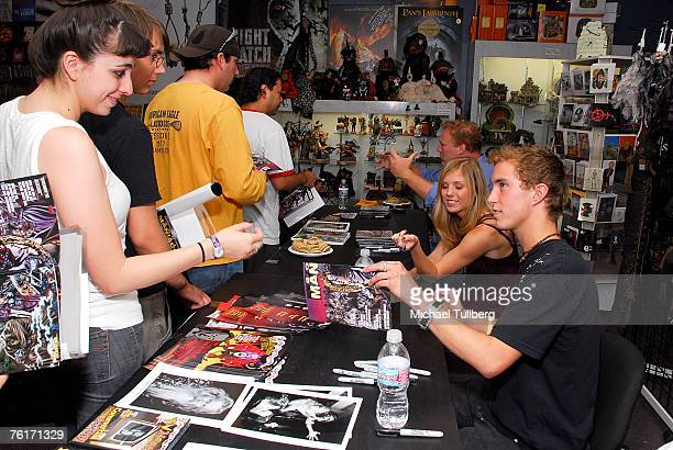 Actors Amy Baniecki and Ryan Fleming talk with fans at an autograph party for the new graphic novel '2001 Maniacs' held at the Dark Delicacies...