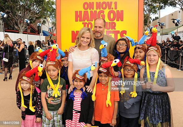 "Actors Amy Poehler and Woody Harrelson attend the premiere of Relativity Media's ""Free Birds"" at Westwood Village Theatre on October 13, 2013 in..."