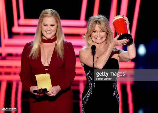 Actors Amy Schumer and Goldie Hawn speak onstage during the 2017 MTV Movie And TV Awards at The Shrine Auditorium on May 7 2017 in Los Angeles...