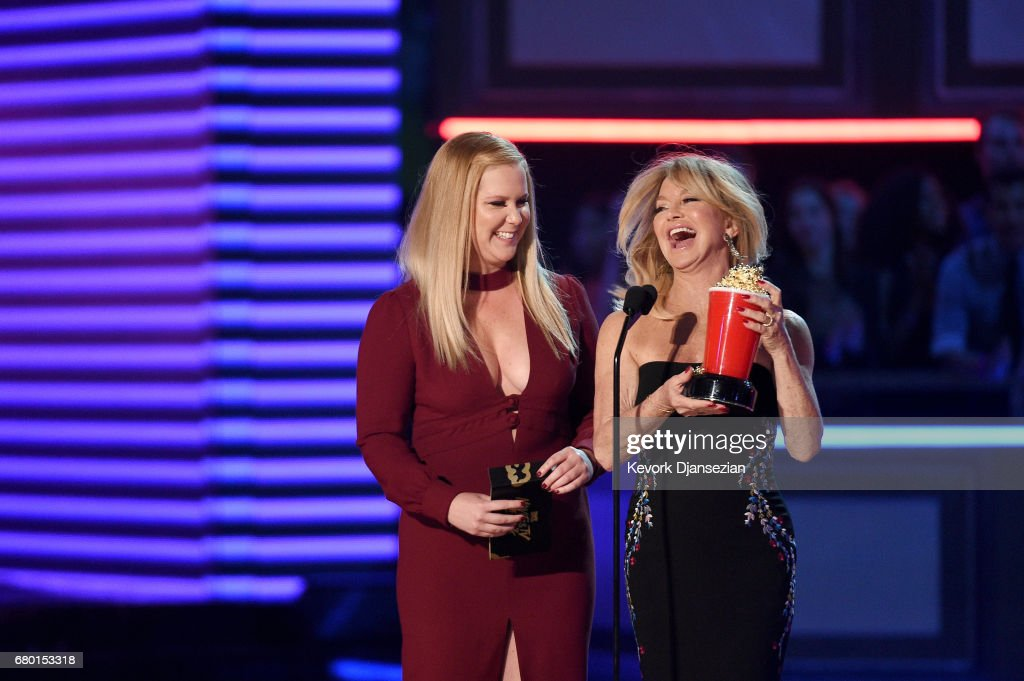 Actors Amy Schumer and Goldie Hawn speak onstage during the 2017 MTV Movie And TV Awards at The Shrine Auditorium on May 7, 2017 in Los Angeles, California.