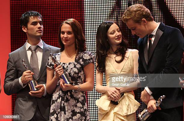 Actors and 2011 Shooting Stars Nik Xhelilaj Alicia Vikander Andrea Riseborough and Alexander Fehling on stage during the 2011 Shooting Star awards...