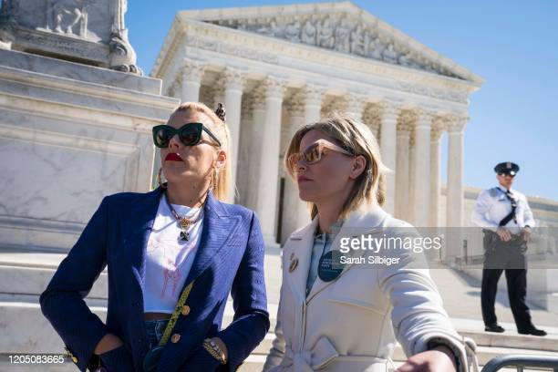 Actors and activists Busy Philipps and Elizabeth Banks participate in an abortion rights rally outside of the Supreme Court as the justices hear oral...