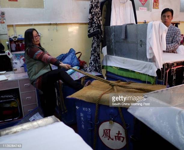 Actors and actresses pack their own belongings at back stage after their last performance in Sunbeam Theatre Sunbeam Theatre where Feng Sheng Hui...