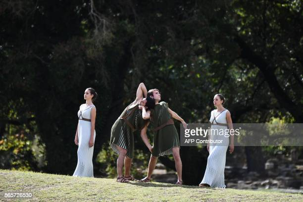 Actors and actresses perform at the Temple of Hera in Olympia the sanctuary where the Olympic Games were born in 776 BC on October 24 2017 during the...