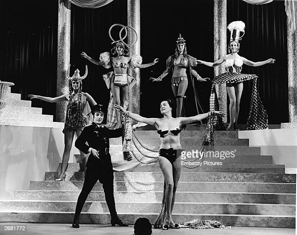 Actors and chorus girls perform on stage in Germanthemed costumes during the 'Springtime For Hitler' musical number in the film 'The Producers'...
