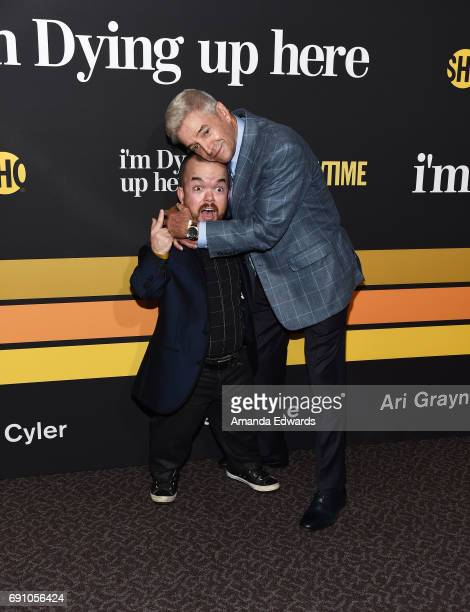 Actors and comedians Brad Williams and Tom Dreesen arrive at the premiere of Showtime's I'm Dying Up Here at the DGA Theater on May 31 2017 in Los...